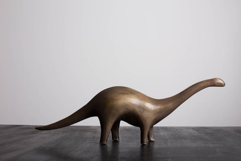A modern bronze Apatosaurus sculpted by Ben & Aja Blanc. Cast in solid bronze, the stylized form emphasizes the fluid qualities of this prehistoric icon.   Limited edition of 25, signed and numbered by the artists. Number offered is 11 of 25.