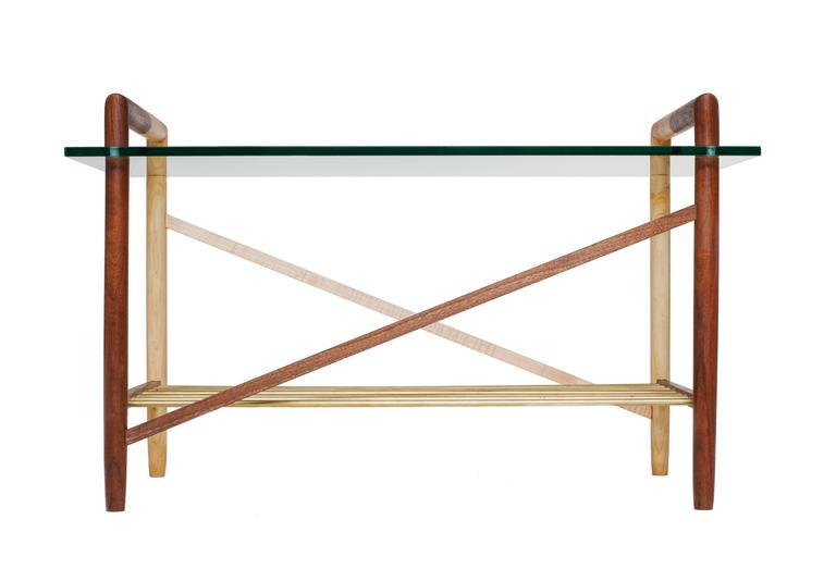 Switchback intersecting wood species. Fine metal shelving rods and polished glass top. Made in Los Angeles, California.  Shown in walnut, maple and brass with clear tempered glass.   Please inquire for custom wood, metal and glass options.