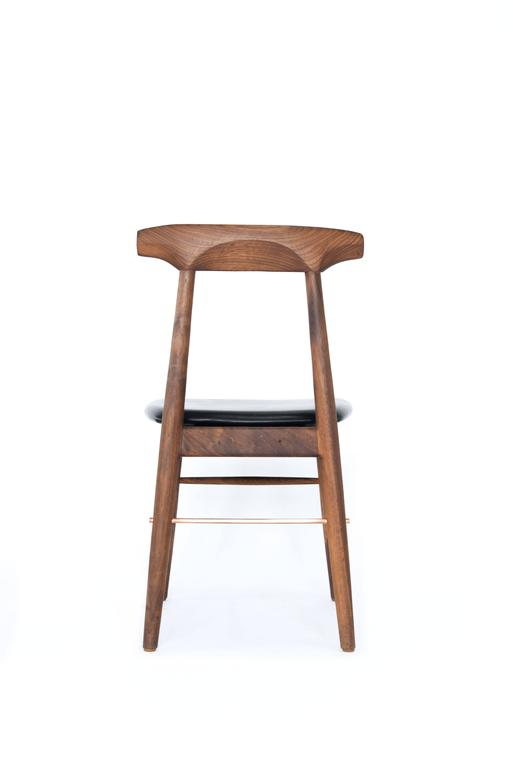 Handcrafted solid wood construction, featuring true copper or brass rods. Made in Los Angeles, California. Shown in walnut, copper, and black leather upholstery.