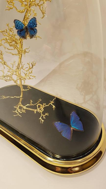 Water gilded dome with a gilded Hawthorn twig and a collection of blue butterflies.