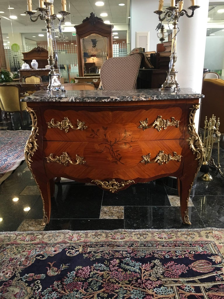 Magnificent 19th century marble-top two-drawer bombe commode from Paris, circa 1880. This commode is made from rosewood and features exquisite floral marquetry decoration and original bronze elements and handles.  Excellent condition. France.