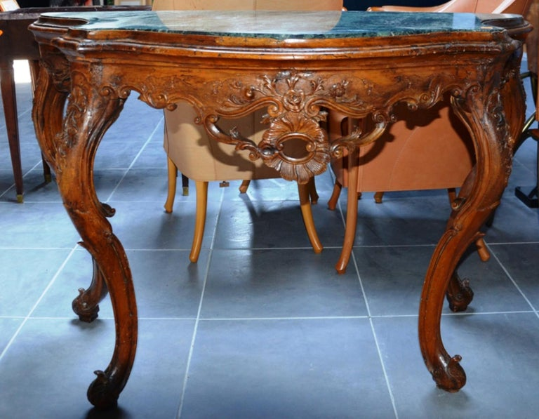 Exceptional walnut hand-carved console with dark green marble-top.