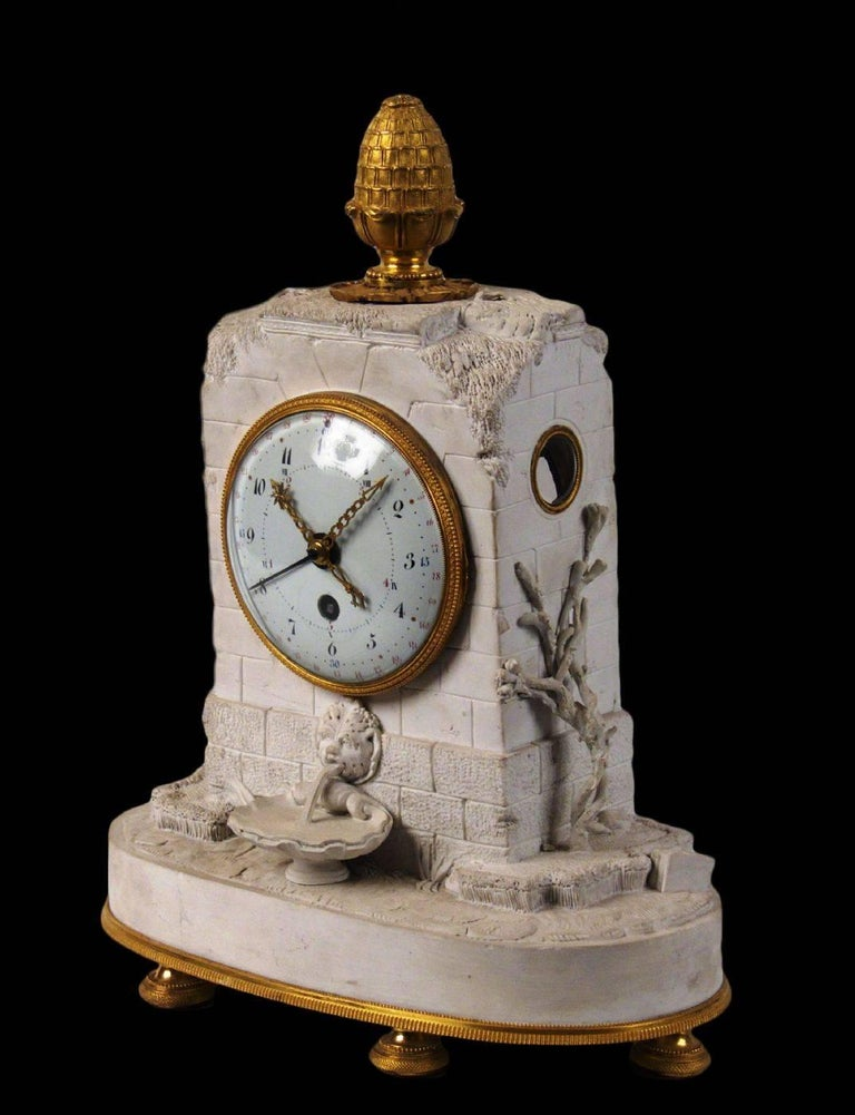 """Clock. decimal Manufacturing: France. Directorate (1793) Sevrés fabric porcelain biscuit, embossed inside the """"Costant"""" biscuit. Enamelled dial by Couteau and golden bronze. Measurements cm: H 35 x 27 x 12.5."""