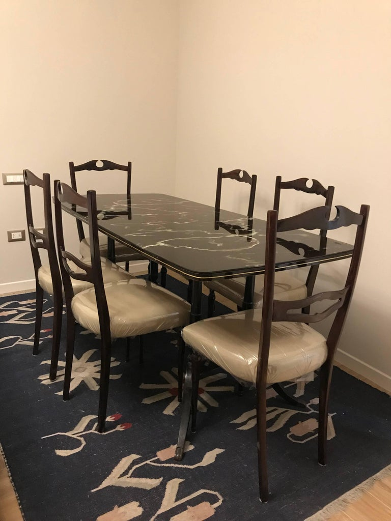 Amazing Mid-Century Modern dining room set consisting of a large table with a beautiful glass top and six chairs in ultimate condition!