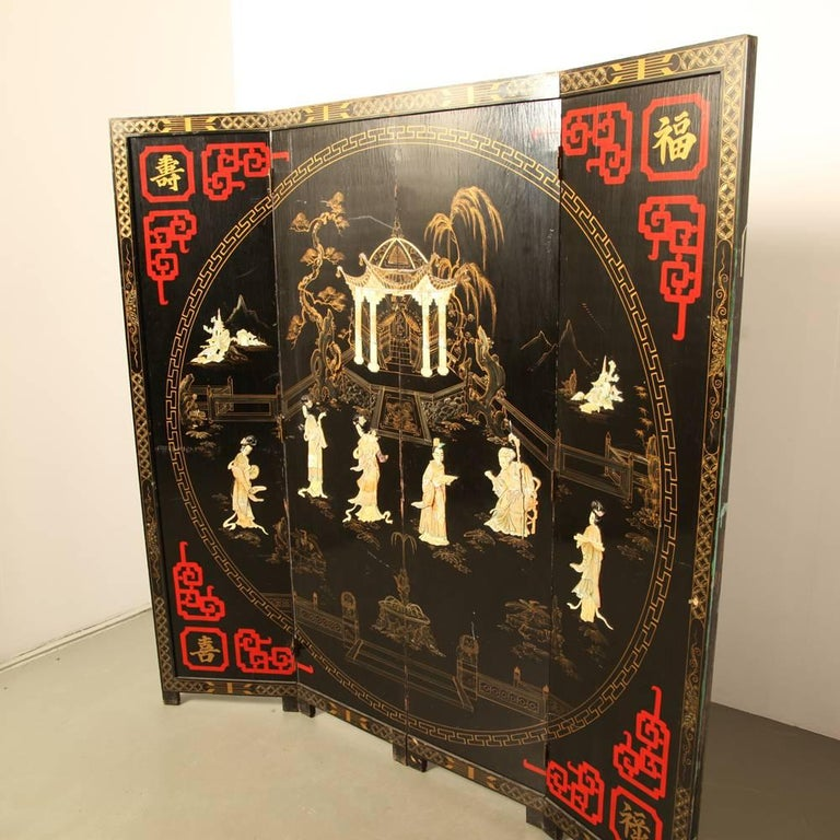 Is it art or is it kitsch? In any case it is very impressive and beautifully made. And old.  Hand-painted, black lacquer and inlaid mother-of-pearl  Dimensions: 3 D x 182 W x 183 H cm  Dimensions folded: 12 D x 46 W x 183 H cm.