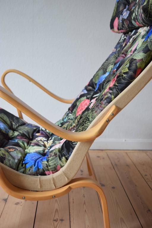 Pernilla lounge chair designed by Bruno Mathsson for DUX. The original Pernilla chair was first designed in 1944. This version is in bent beech and has a new cushion and 'tropical' themed fabric.