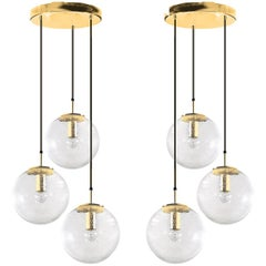 Pair of Brass Cascades with Three Handblown Globes by Glashütte Limburg
