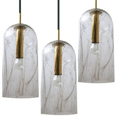 One of three Textured Glass Pendant Lamps by Doria, 1960