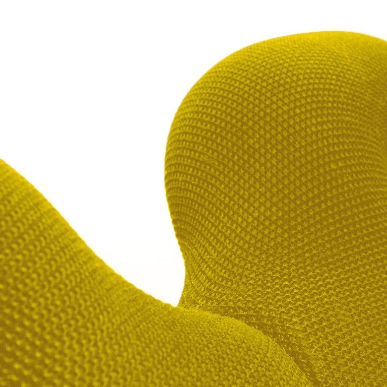 A pair of iconic and stylish armchairs handcrafted from Norway. Designed by Terje Ekstrom.  The chairs are both modern and yet very functional. The design dates from the late 1970s. The color is yellow. It's distinguished by its design purity and