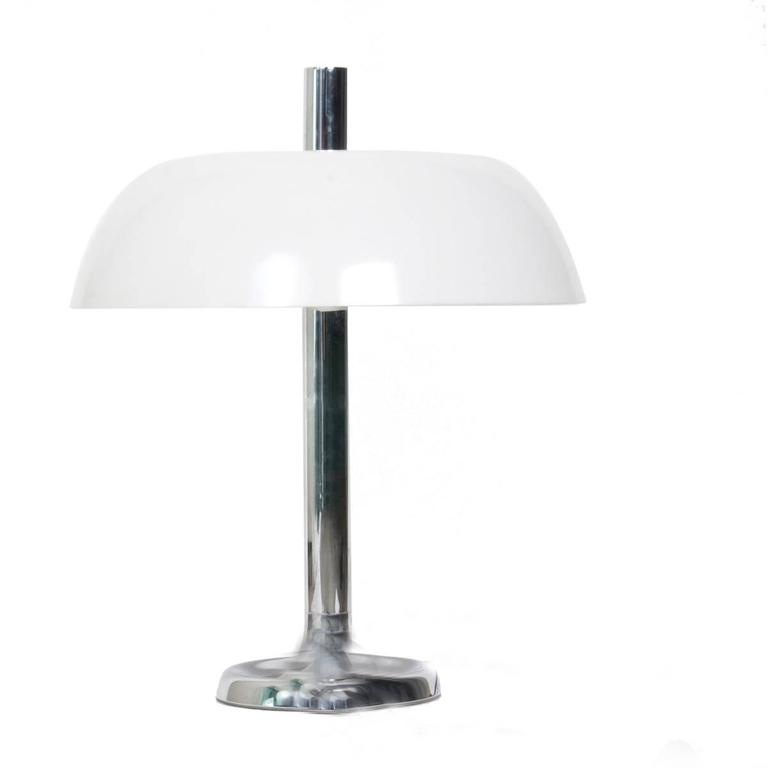 Pair of large table lamps with three E27 bulbs by Hillebrand, Germany with a chrome base and a white plastic molded shade. With on/off switch.  The stylish elegance of this lamp suits many environment, from Mid-Century to Danish modern and Space