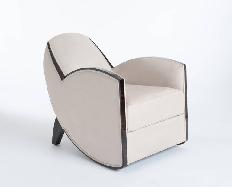 A pair of very elegant and extraordinary shaped Art Deco (re-produced) armchairs, in the style of Jules Leleu. Fine Macassar veneer in combination with sandy colored alcantara leather fabric from Èlitis / France.