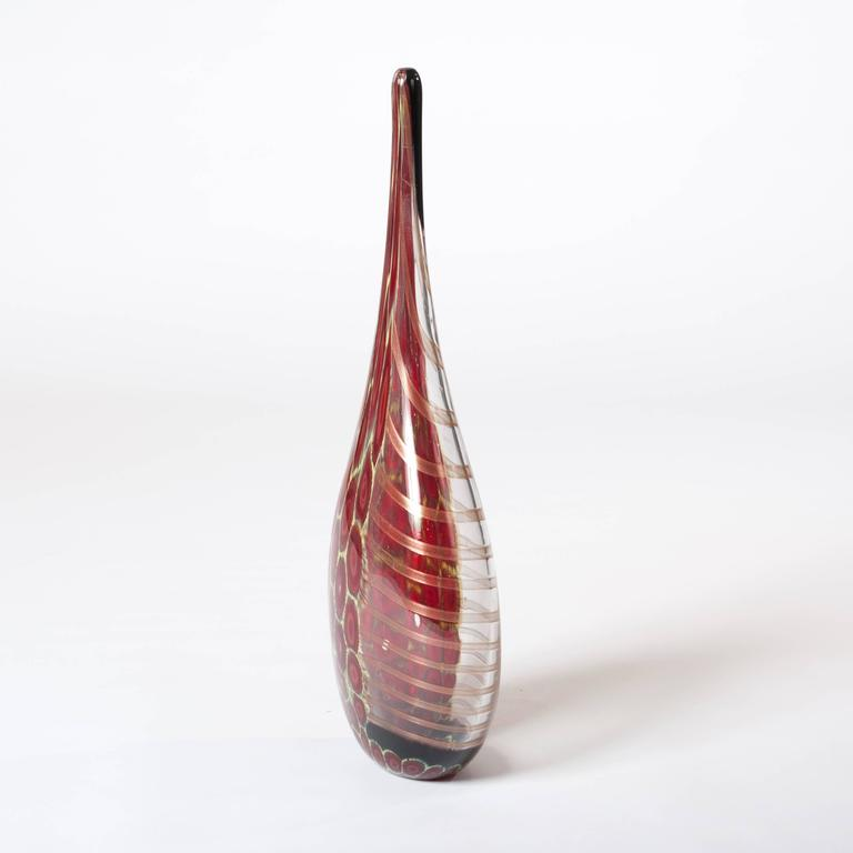 Elegant and tall bottle-shaped Murano glass vase clear glass, dark-red and yellow murrhines on one side and on the other side metallic-cognac colored stripes. Handsigned: I Muranesi - Limited Edition - 1/1.