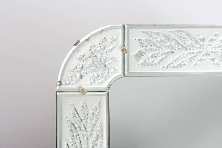Particular Scandinavian Art Déco mirror, the engraving of the frame looks like frozen leaves and the edges of every single piece show tiny bevelling. Original glass and wooden backside.