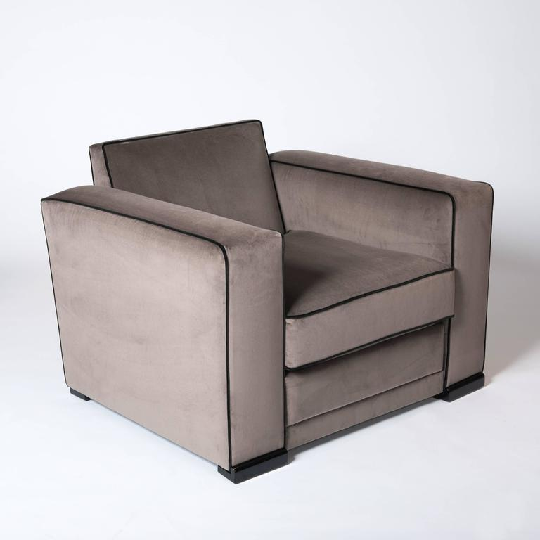 French Art Dèco club chairs attributed to Jacques Adnet. Full restoration and update on the inside of the chairs - new upholstery with a cotton velvet fabric  color taupe with black piping from Pierre Frey, Paris. The feet are re-lacquered in high