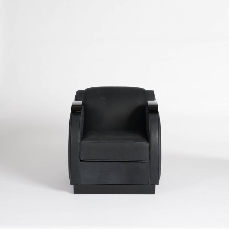 Unique Art Deco club chair with curved arms and sides. The wooden frame is completely re-lacquered in high gloss black finish the upholstery is completely re-worked, the cover fabric is an anthracite nubuck leather with piping in perfect man-made