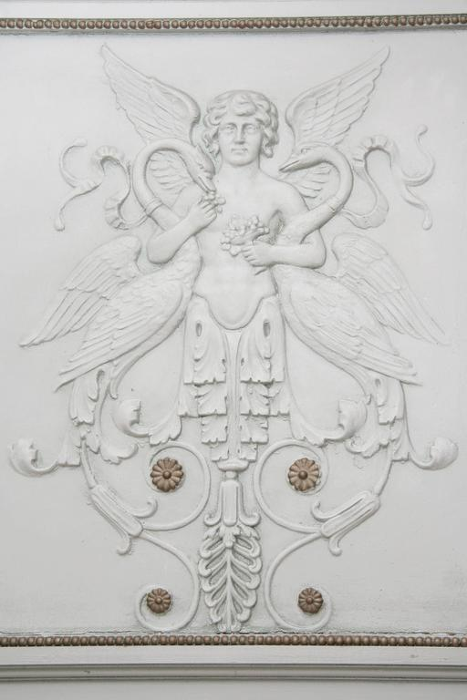 Large French Napoleon III trumeau mirroir with classical elements, patinated in light grey color. The superior part is characterized by an exposure of stylistic elements - classical angel surrounded by swans, leaves, blossoms and rosettes - The