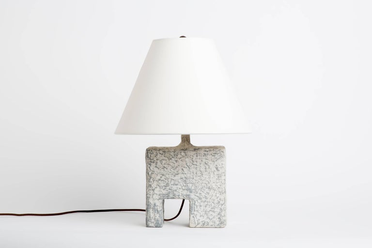 This lamp is 1 of 5 lamps of Dolatowski's cast resin table lamp series. This resin lamp is organic, modeled and textured in form.   Wired to US standards. Shade is not included.   Influenced by his travels in Asia and the Middle East, Dolatowski's