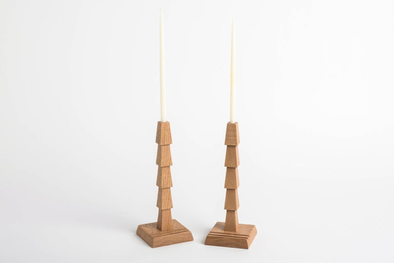 """Made from white oak, this is a unique edition from Erik Gustafson. Other designs available, including a darker stain option. Candlesticks built for 7/16"""" diameter candles, appropriate candle spec will be provided.   Gustafson's inspiration"""