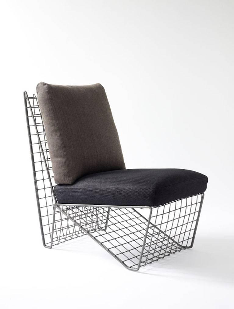 Metal frame and upholstered cushion chair.   Includes cushions upholstered as shown in images, in very good condition.