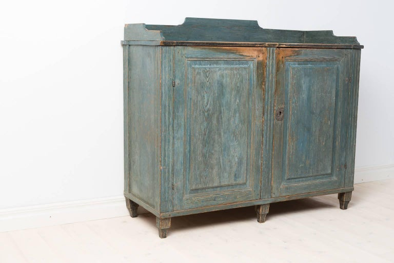 Rare period gustavian sideboard from northern Sweden. The front is dry scraped to the blue original paint. The inside in completely untouched with its original dark blue paint. Original lock.  Sweden circa 1780