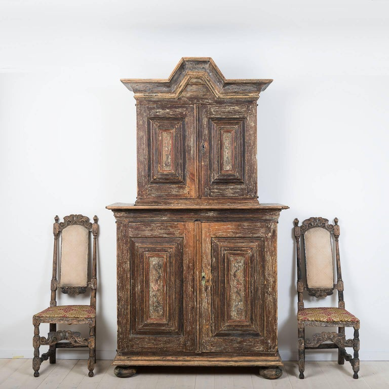 Swedish baroque cupboard that's dry scraped down to the first layer of paint from the mid-1700s. The door-mirrors have traces of decorative painting. 