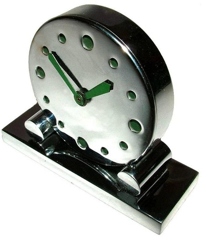 Very rare miniature modernist chrome clock, totally authentic and one we've not come across ever before in our 20 years of specialising in Art Deco. The numerals and hands are in green enamel. Condition is above average the chrome is bright and