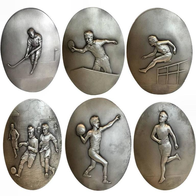 super rare set of 1930s art deco sporting metal plaques at 1stdibs. Black Bedroom Furniture Sets. Home Design Ideas