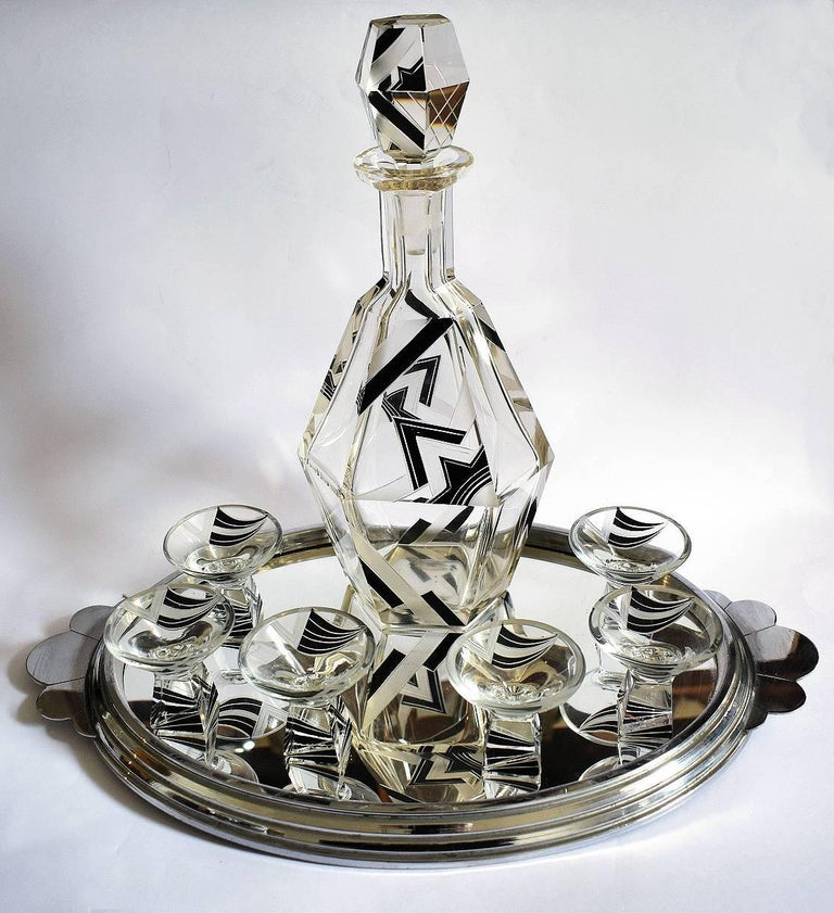 Very stylish Art Deco decanter set comprising decanter and glasses. Please not the tray shown is not part of this sale but can be purchased separetly. Huge cut-glass decanter and six conical shaped glasses. The decanter is deceptively heavy and is