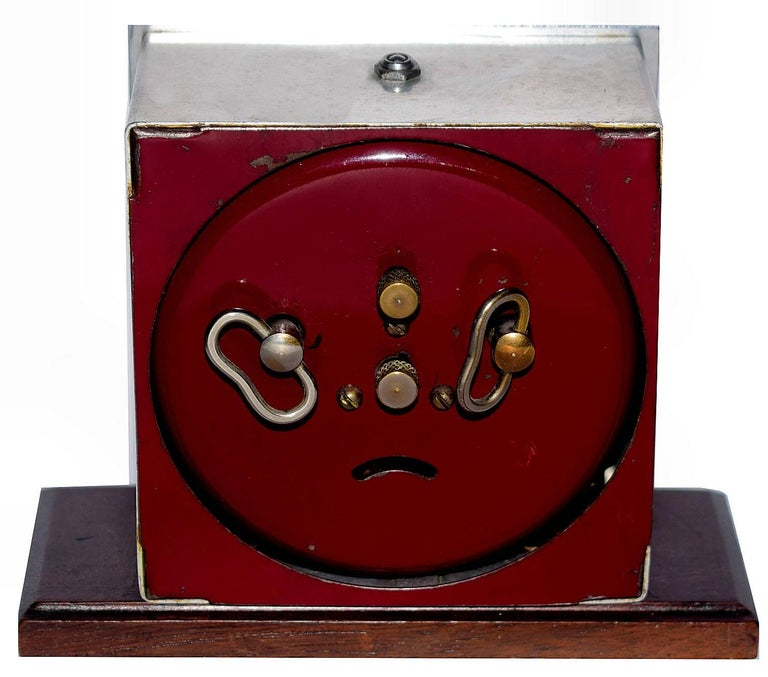 One of my personal favourite makers of French clocks is this clock by Blangy. The stylized numerals are the epitome of Art Deco. The whole body of the clock is chrome which rests on a Mahogany plinth and has a burgundy colored back cover. The dial