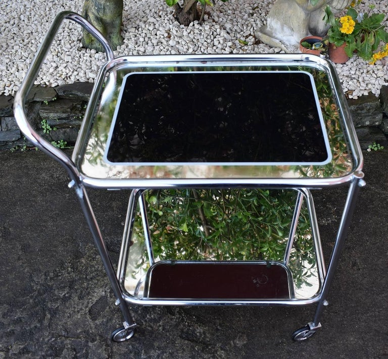 Now this really is a fabulous hostess trolley! Original 1930's Art Deco chrome two-tier trolley, with black and mirrored edged glass, very glam! All totally original and in great condition. These are fab for displaying cocktail shakers, glass and