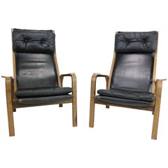 Pair of Yngve Ekstrom Armchairs in Black Leather and Wengé, 1960s
