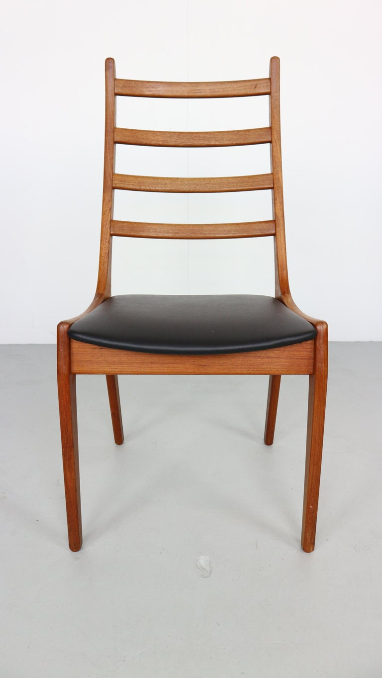 These stunning midcentury dining chairs were crafted by high end Danish maker Korup Stolefabrik. Subtle features such as the finger grip joints are a great design feature and a tribute to the quality of construction. Seats are newly upholstered in