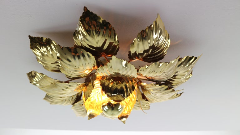 Vintage Mid-Century Modern, Willy Daro brass wall or ceiling light with brass leave ornaments made in 1970s.