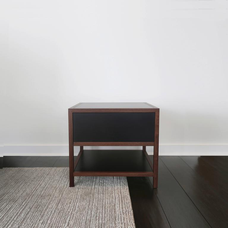 Framed in solid walnut and clad with a recycled paper composite, the Driver Side Table blends classic triple miter joinery with modern building materials. The composite, made of FSC Certified Recycled Paper, has a wax finish that develops a rich