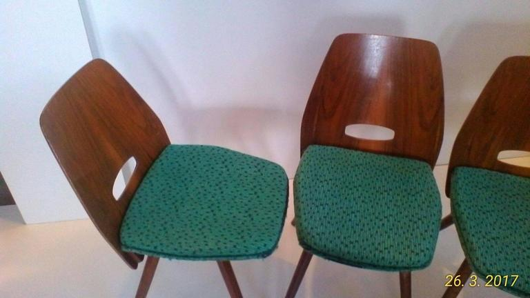 A set of four Art Deco dining chairs in beech. The chairs were produced by Tatra Pravenec, Czechoslovakia in 1960s. Chairs in original, very good vintage condition.