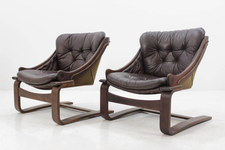 The frame is made from stained bentwood plywood and was partly refurbished . The seats consist from canvas and leather pillows. The chairs are in very good condition and they are very comfortable