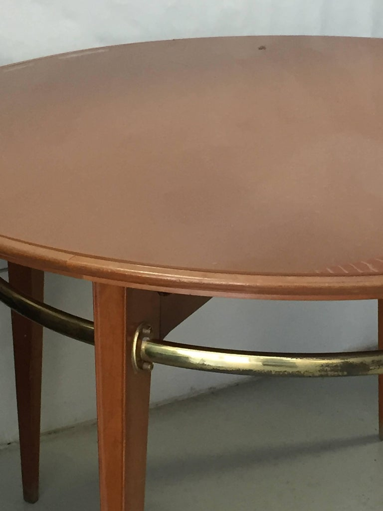 Gio Ponti (attributed), wooden dining table with a brass band under the plane, circa 1950.