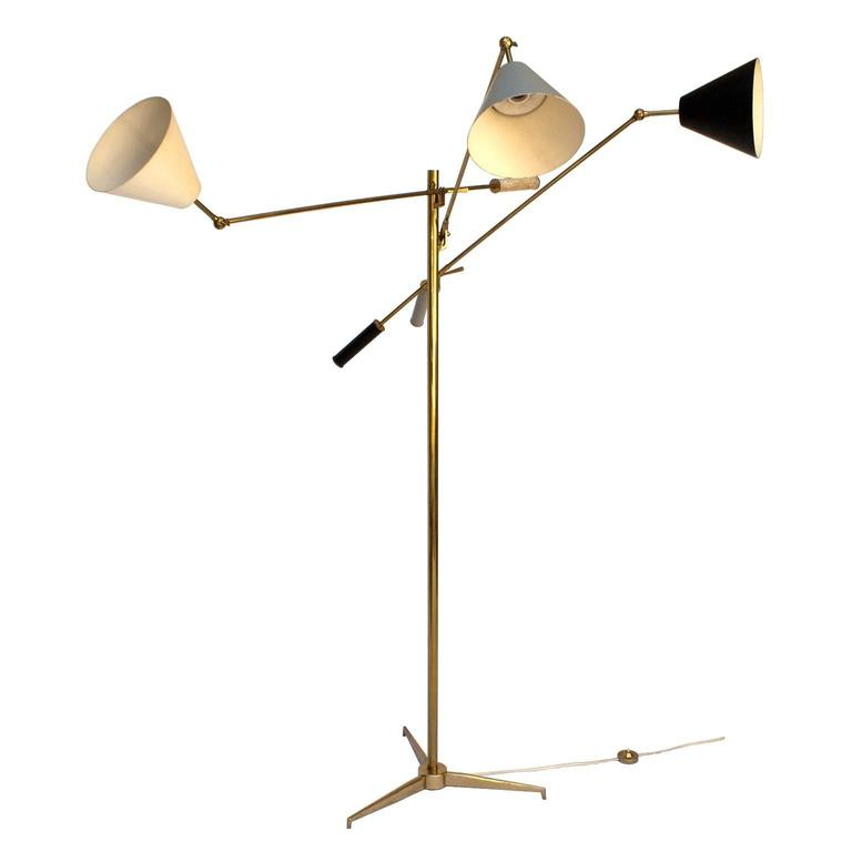 Three light adjustable floor lamp designed in 1947 by Angelo Lelii for Arredoluce. Brass structure, adjustable lacquered metal lampshades. Marked on the metal. H max 180 cm, H min 120 cm. Please contact me for shipping cost to worldwide.