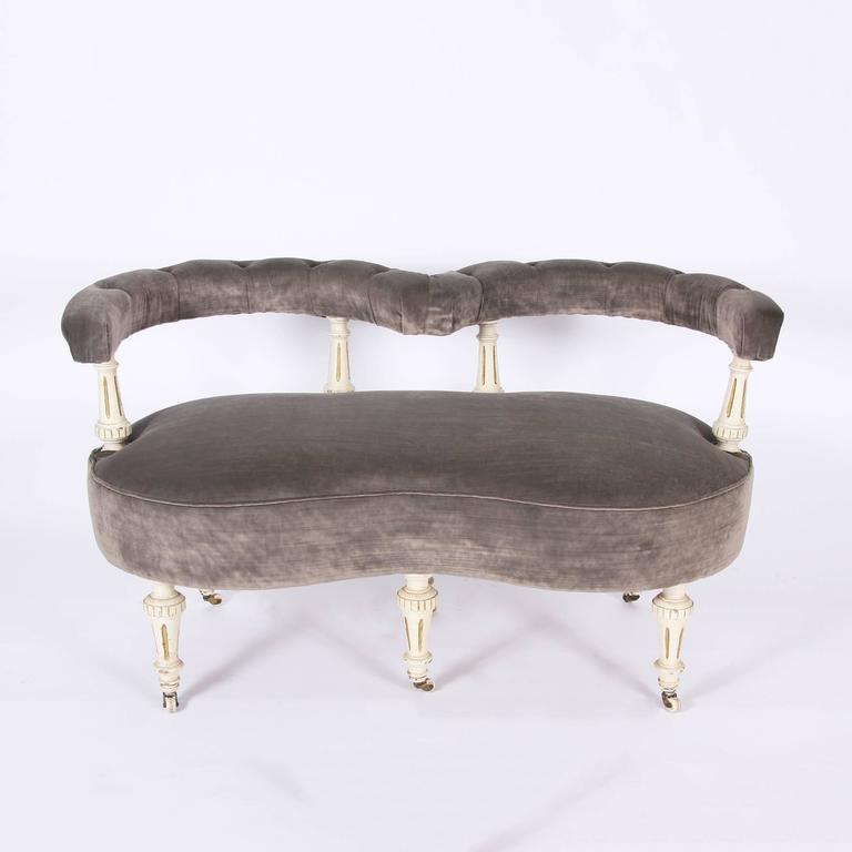 Love seat re-upholstered in a lovely luxurious velvet. Carved wood frame, with original paint.