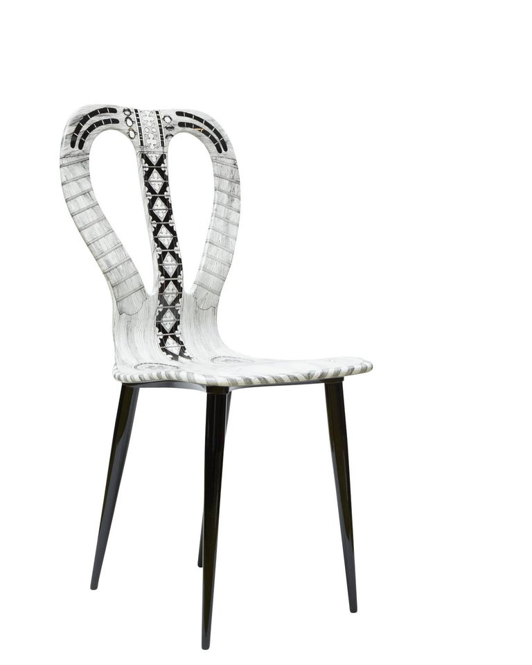This chair is hand painted, 3 of 10 made in 2016.  The Italian artist and illustrator Piero Fornasetti was one of the wittiest and most imaginative design talents of the 20th century. He crafted an inimitable decorative style from a personal
