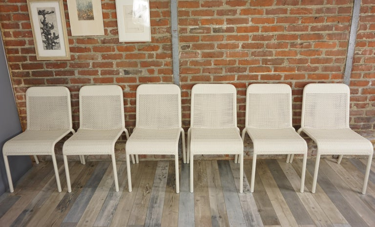 Set of six white braided resin chairs indoor/outdoor. Design and retro style, practical (stackable!) They will be perfect on your terrace, in your veranda, around the swimming-pool, your winter garden, even around the dining table! New items, never