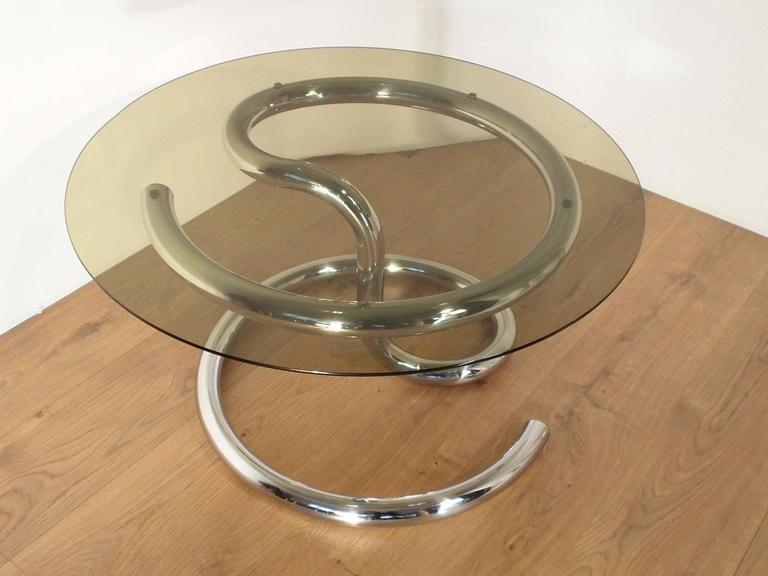 Anaconda coffee table designed by Paul Tuttle for Strässle in the 1970s. It features a chromed metal snake-shaped base with a glass top.