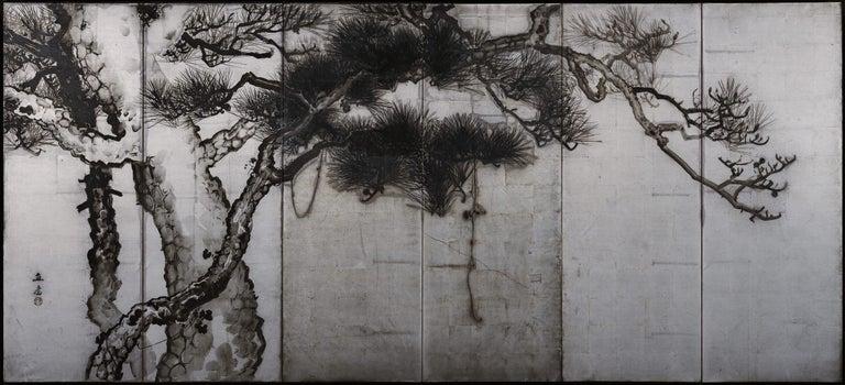 "Pine trees  Uenaka Chokusai (1885-1977)  Pair of six-fold screens.  Late Meiji period, circa 1910.  Ink and silver leaf on paper.  Signature: Chokusai  Seal: Chokusai  Dimensions:  Each: 172 cm x 378 cm (68"" x 149"")  This"