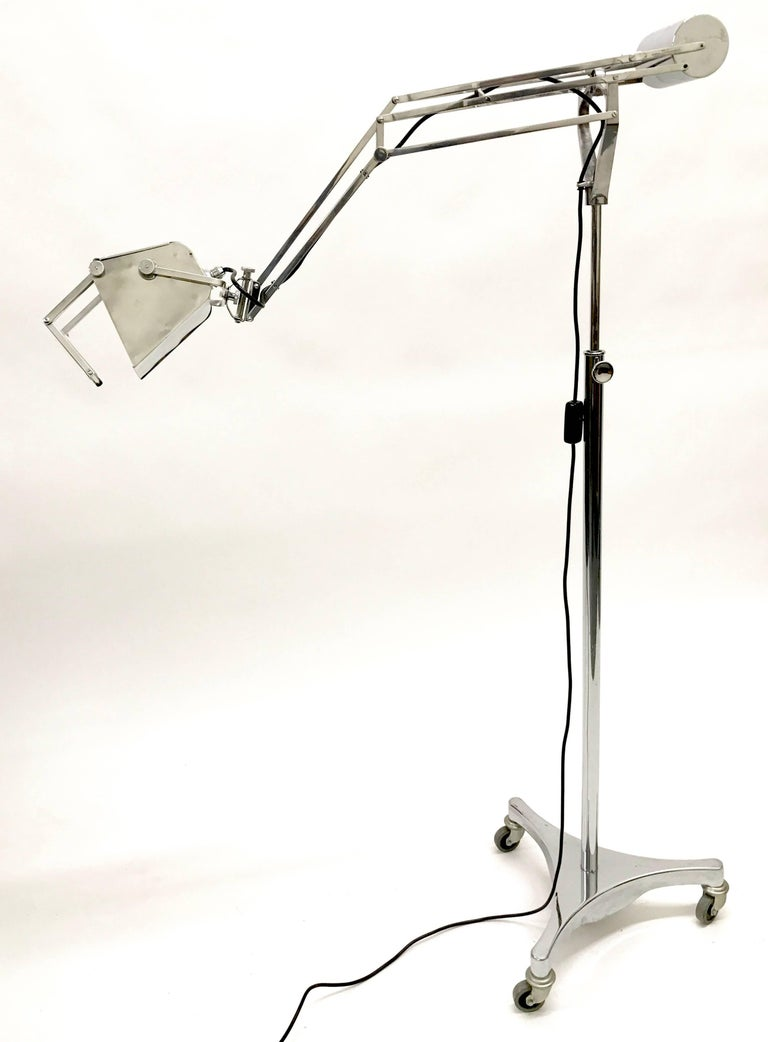 Hadrill and Horstmann counter balance trolley floor lamp with a magnifying lens, 1950s.