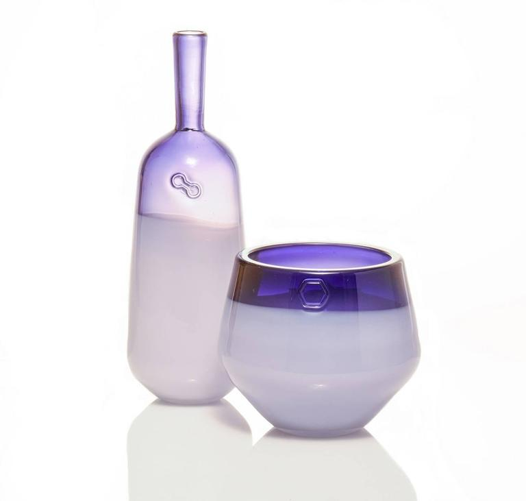 The Branded series is a set of modern design objects which each feature a hand impressed brand that highlights these wholly handmade vessels. For color, each piece features a transparent tone on the entire piece with an opal white overlay on the