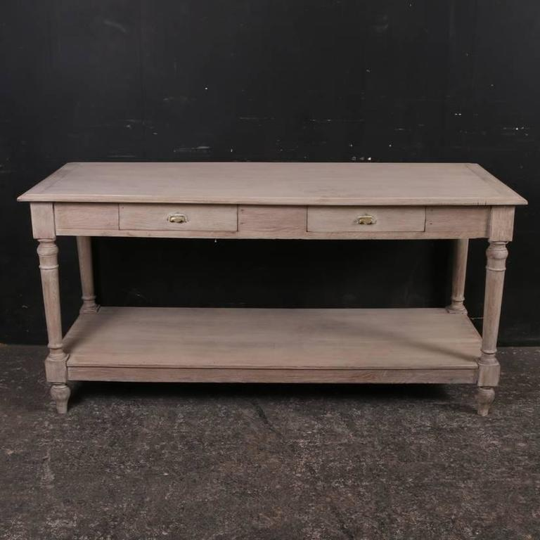 Good 19th century French bleached oak drapers table, 1880   Dimensions 67 inches (170 cms) wide 27.5 inches (70 cms) deep 33 inches (84 cms) high.