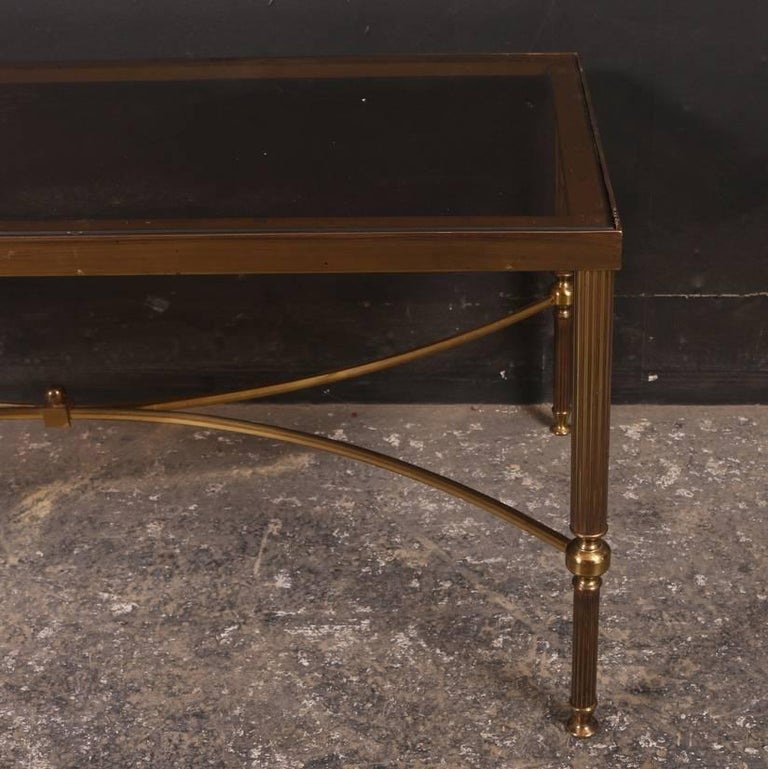 1920s Brass and glass low table. 1920  Reference: 4967  Dimensions 35.5 inches (90 cms) Wide 18 inches (46 cms) Deep 16 inches (41 cms) High