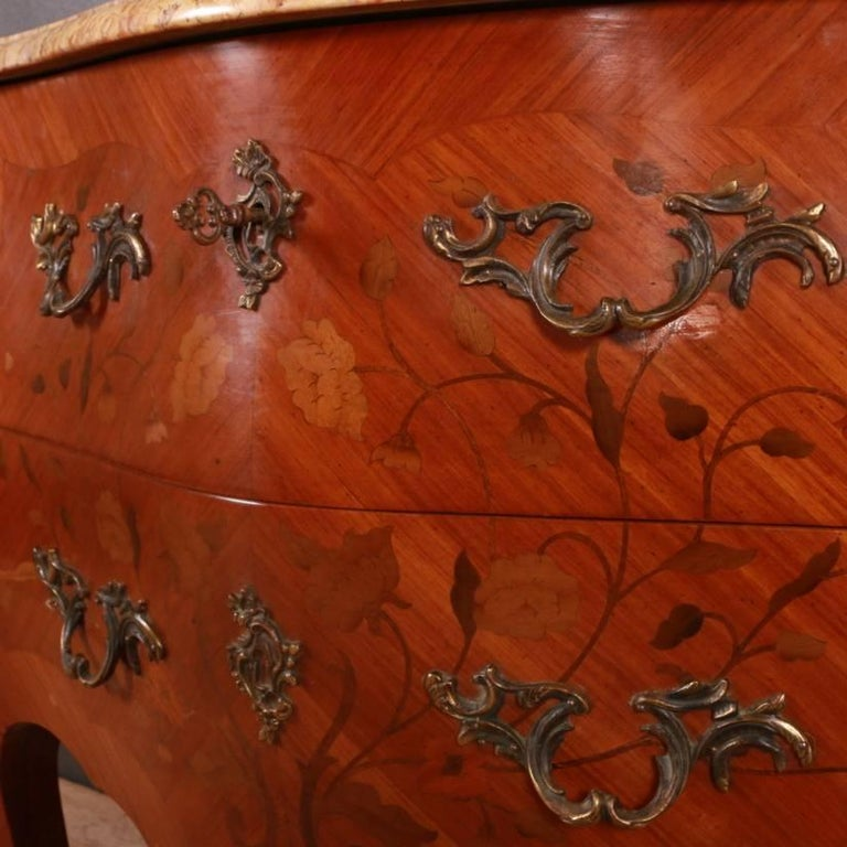 Late 19th century French bombe two-drawer marquetry commode with ormolu decoration, 1890.