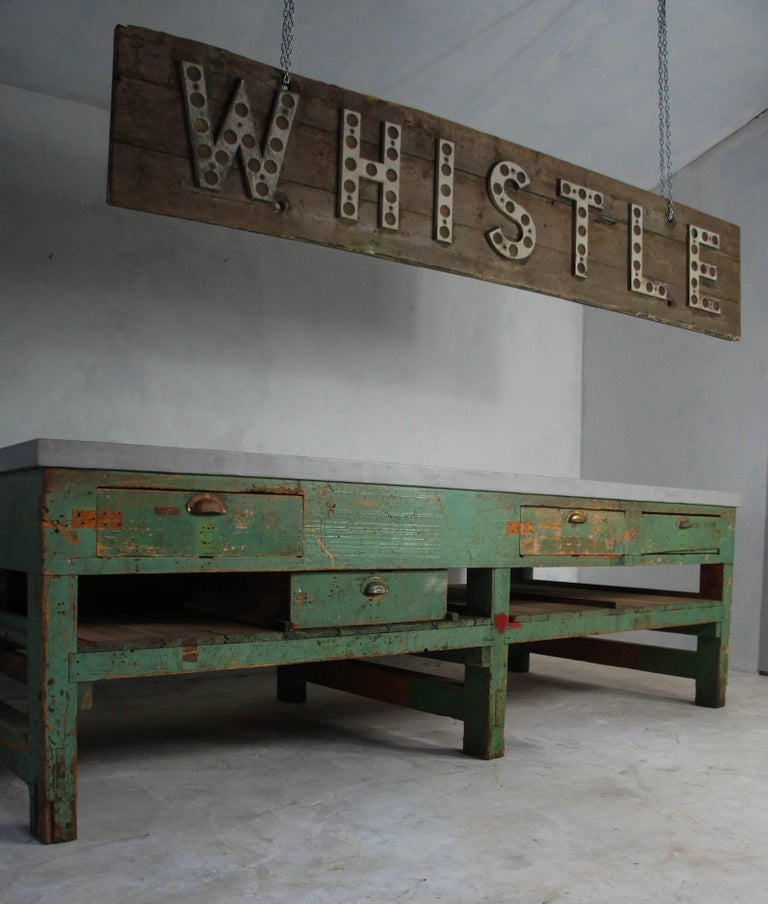A very rare and hard to find large Industrial wooden sign from the height of the UK's railway era. Raised lettering with reflectors, spelling 'Whistle', is mounted on wooden boards with glimpses of old green paint still visible. Originally used to