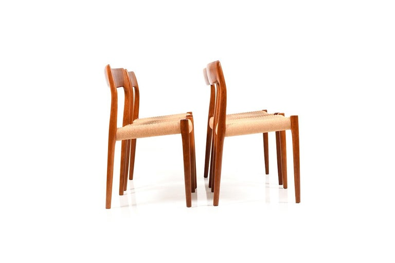 Set of four dining chairs in solid teak by Niels O. Møller. Model no.78. Seats in original papercord. Produced by J.L. Møllers Møbelfabrik, 1960s.